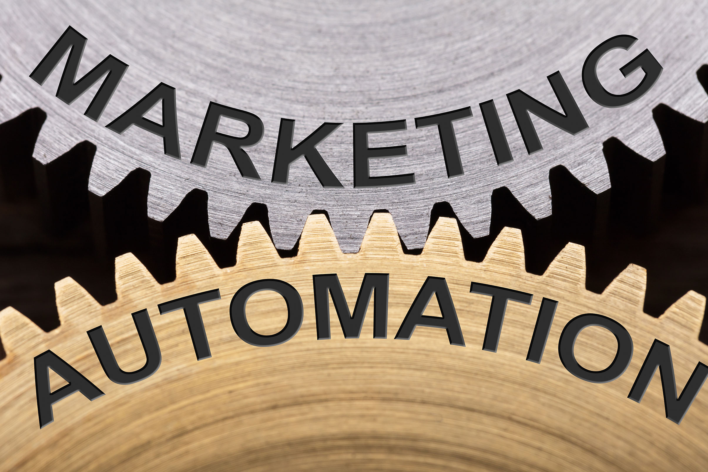 Closeup of marketing automation concept on interlocked cogwheels